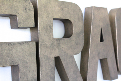 Bronze faux metal wall letters.
