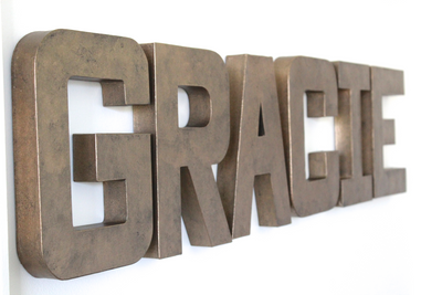 Gracie bronze letters for teenage room decor.