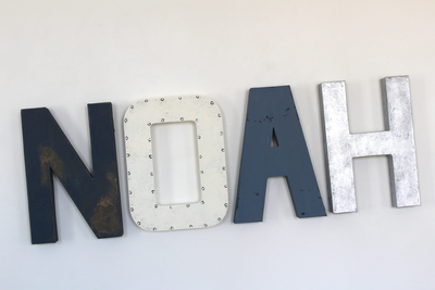 Noah custom wall letters in navy, white, and silver for nautical nursery decor.