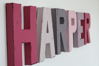 Pink and purple nursery wall letters spelling out the name Harper.