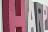 Different shades of pink and purple letters make up the name Harper for nursery wall letters.