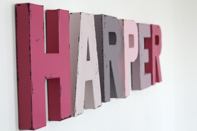 Harper girl's name wall letters in shades of pink and purple.