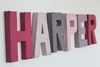 Harper nursery letters in pink and purple.
