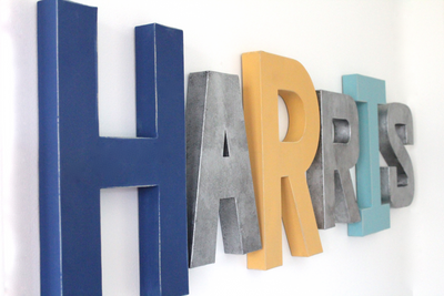 Name wall letters in different sizes and colors spelling out the name Harris.