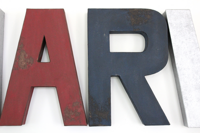 Distressed red and navy nursery letters.
