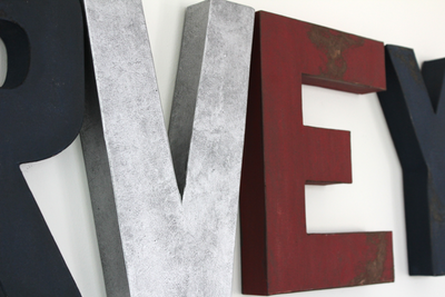 "Silver ""metal"" letter and a rustic red E for a preppy boys room theme."