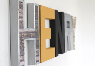 Modern industrial nursery letters spelling out Henry.