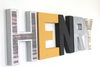 Henry nursery letters in industrial modern colors and textures such as silver, black, brown, and yellow.