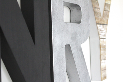 Black and silver modern industrial nursery letters.