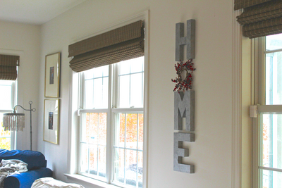 HME Home wall letters with a red wreath instead of the letter O.