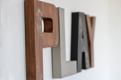 Woodland playroom letters in brown, black, and grey.