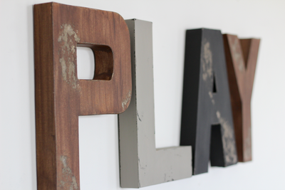 Woodland playroom letters for rustic nursery themes.