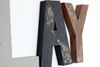 Distressed letters for woodland playroom decor in grey, black, and brown.