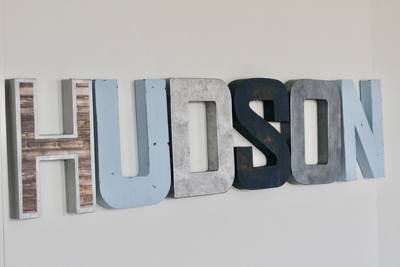 Hudson nursery letters in blue, silver, brown, and grey.