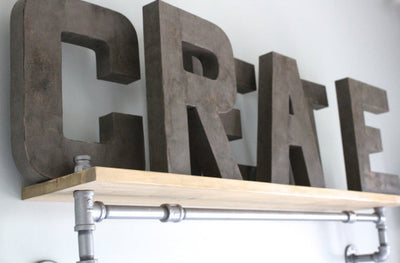 "CREATE ""wooden"" and distressed letters on a pipe shelf"