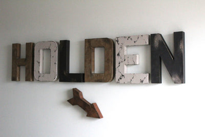 """Wooden"" Holden boy name on nursery wall with brown ""wooden"" arrow"