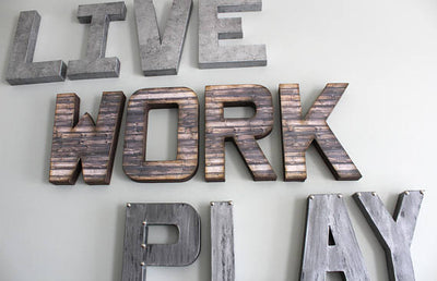 "Close up of LIVE WORK PLAY ""metal"" and ""wooden"" letters"