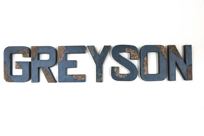 Blue nursery distressed letters spelling out a boys name Greyson.