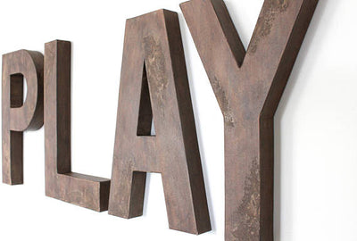 Playroom sign in brown
