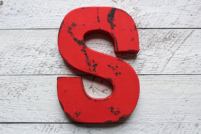 "Red ""wooden"" distressed letter in a vintage style"