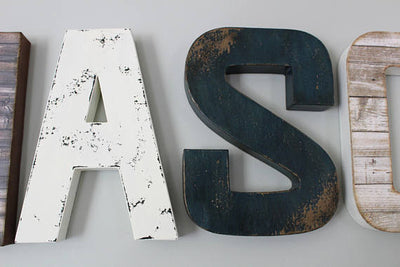 """Wooden"" distressed letters A and S in a white and navy color"