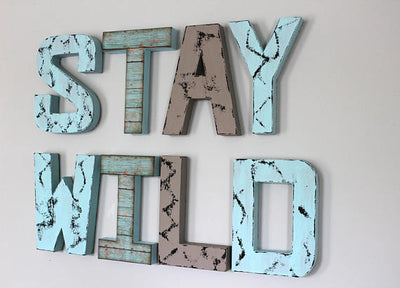 playroom sign stay wild in blue and grey letters