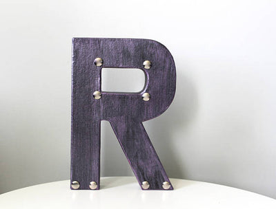 "Freestanding letter R in purple ""metal"""