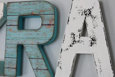 Distressed gender neutral nursery letters for boho woodland nursery decor.