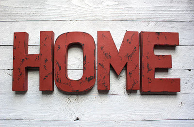 "Burgundy HOME style vintage letters in a ""wooden"" look."