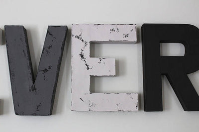 Grey, white, and black modern nursery letters