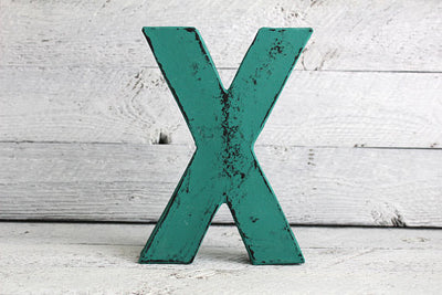 "Chic ""wooden"" teal letter X in a bohemian chic vintage style"