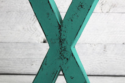 """Wooden"" letter X in teal"