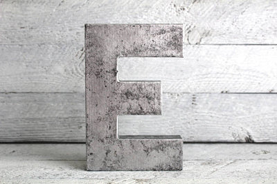 Industrial silver letter E for custom wall signs.