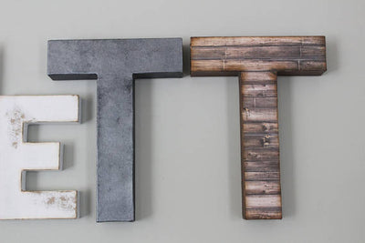 white and silver nursery letters in a faux metal and wood finish.