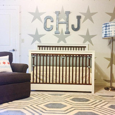 Nursery room monogram Initials in silver over a crib