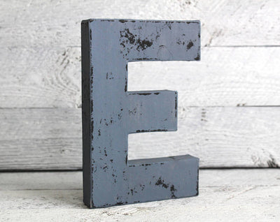 vintage looking letter E in a dark blue color.