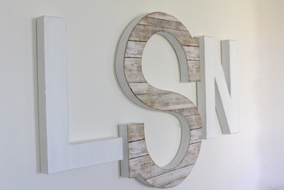 "White nursery monogram wall letters with a larger middle initial S in a beach reclaimed ""wooden"" look."