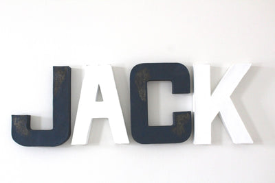 Boys nautical nursery wall letters spelling out Jack in navy and white traditional colors.