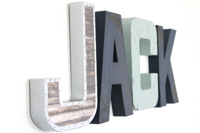 """Metal"" and ""Wooden"" wall letters in shades of blue spelling out Jack."