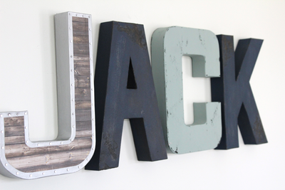 Industrial navy and blue wall letters spelling out Jack.