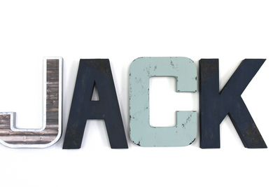"Blue wall letters in an industrial ""metal"" and ""wood"" finish spelling out Jack."
