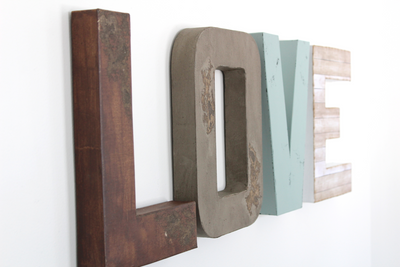 Distressed LOVE sign in different colors and textures.