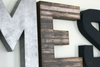 Custom wall letters in silver, brown, and navy for boys nursery decor.