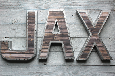 JAX metal and faux wooden reclaimed letters with a nail head trim design.