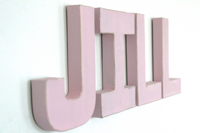"Pink ""wooden"" nursery name letters spelling out the name Jill."