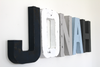 Nautical letters spelling out the name Jonah for a boys nautical nursery.
