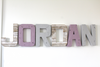 Jordan girls name wall name sign in purple and gray.