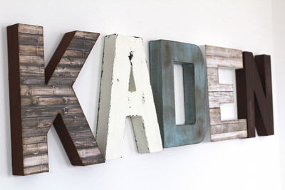 blue rustic baby boy room name sign on the wall in rustic letters