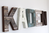 Farmhouse nursery decor name letters spelling out the name KADEN in different colors and textures such as brown, white, and blue.