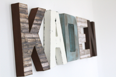 Boy nursery wall decor custom wall letters in different textures and colors spelling out the name Kaden for a farmhouse nursery.